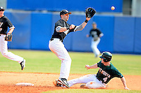 Long Island Blackbirds shortstop John Ziznewski #5 takes a throw as Jeff Keller #4 slides in during a game against the Dartmouth Big Green at Chain of Lakes Stadium on March 17, 2013 in Winter Haven, Florida.  Dartmouth defeated Long Island 11-4.  (Mike Janes/Four Seam Images)