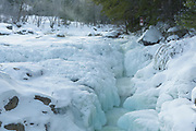 Frozen cascade at Rocky Gorge Scenic Area, along the Swift River, in Albany, New Hampshire during the winter months. Designated a scenic area in 1961, the Rocky Gorge Scenic Area is a 70-acre tract of land along the Kancamagus Highway.