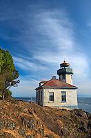 WASJ_D146 - USA, Washington, San Juan Island, Lime Kiln Point State Park, Lime Kiln Point Lighthouse and rocky shoreline beneath a cirrus filled sky.