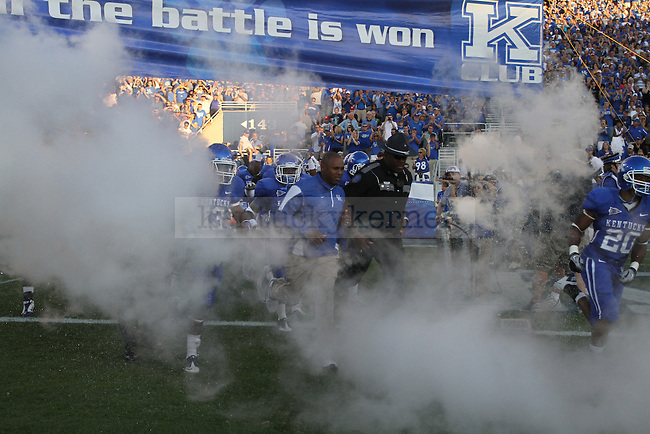 Head coach of the University of Kentucky wildcats, Joker Phillips, led the team onto the field at Commonwealth Stadium on Sept. 18, 2010. Photo by Latara Appleby | Staff