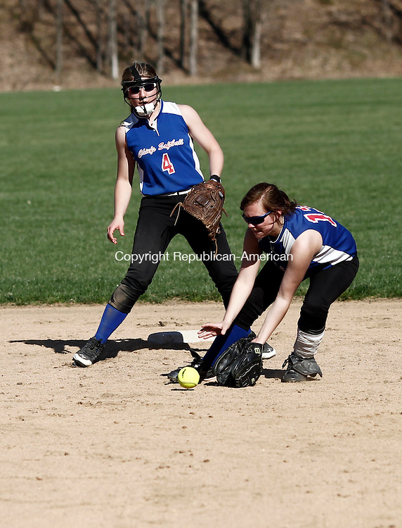 Woodbury, CT- 21 April 2014-042114CM05-  Nonnewaug's Amanda LoRusso, right, fields the ball during their Berkshire League matchup against Housatonic in Woodbury on Monday.  Also in on the play is teammate, Marissa Valente.   Christopher Massa Republican-American