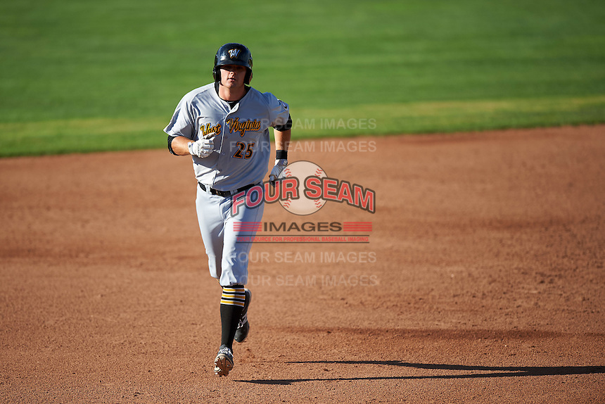 West Virginia Black Bears first baseman Albert Baur (25) running the bases after hitting a home run during a game against the Batavia Muckdogs on August 21, 2016 at Dwyer Stadium in Batavia, New York.  West Virginia defeated Batavia 6-5.  (Mike Janes/Four Seam Images)