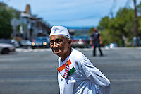 A man crosses the street as he takes part in the annual Indian independence day parade in New Jersey,  August 11, 2013. Photo by Eduardo Munoz Alvarez / VIEWpress.