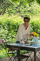 Michela Goldschmied lays a tiled table in the garden for an al fresco lunch