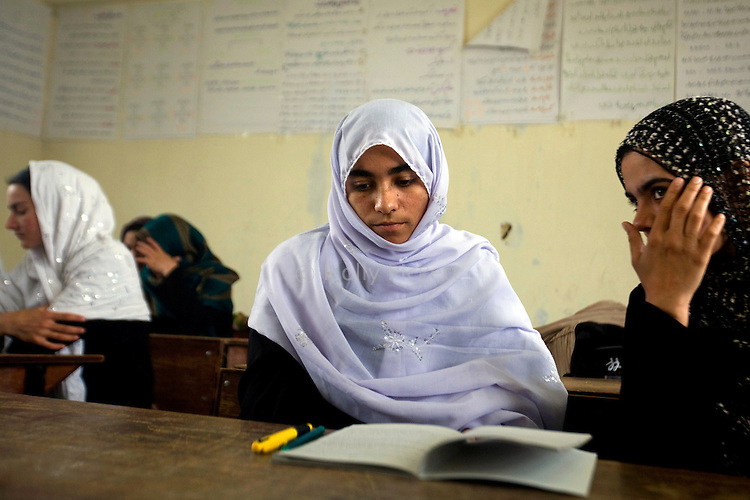 Shamsia Husseini, 17, attends her Dari class at Mirwais School for Girls in Kandahar, Afghanistan, Monday morning, April 20, 2009. On Nov. 12, 2008, men on motorcycles threw or sprayed acid on 11 students, including Husseini, and four teachers as they walked to school that morning. Husseini had to seek treatment abroad for her injuries. She is the only one of those attacked who has returned to school. Girls' enrollment at public schools has fallen throughout Kandahar because of decreasing security, but is increasing at literacy programs.