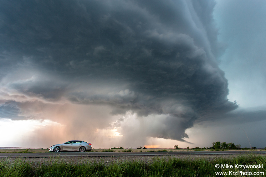 Supercell thunderstorm above a car on a highway in Kansas, May 10, 2014
