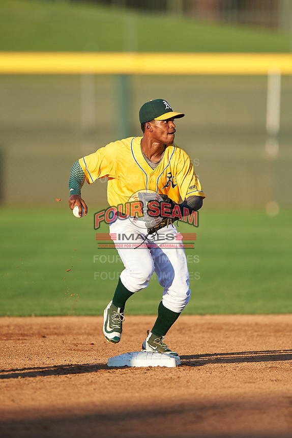 AZL Athletics Gold shortstop Elvis Peralta (3) turns a double play during an Arizona League game against the AZL Rangers on July 15, 2019 at Hohokam Stadium in Mesa, Arizona. The AZL Athletics Gold defeated the AZL Athletics Gold 9-8 in 11 innings. (Zachary Lucy/Four Seam Images)