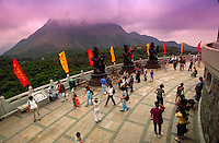 Tourists mingle with disciples at Tian Tan Buddha, Lantan, China