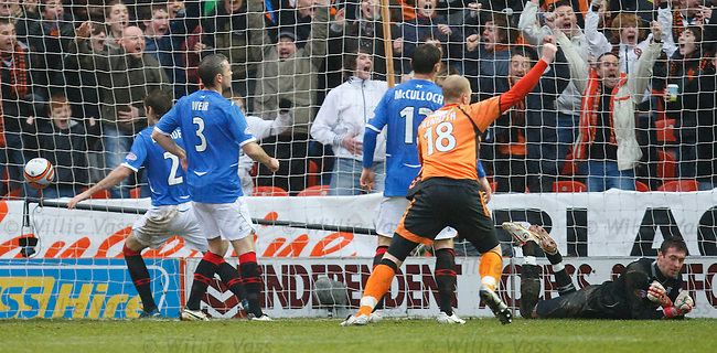 Allan McGregor clutching at thin air as Lee Wilkie's shot hits the back of the net