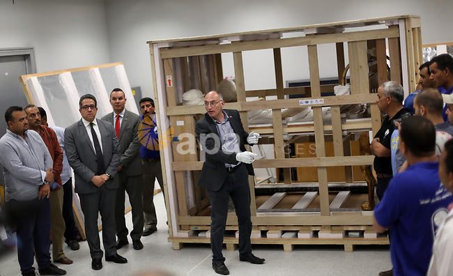 Egyptian workers open a box containing the funerary bed of ancient King Tutankhamun at the Grand Egyptian Museum (GEM) near the Pyramids Plateau in Giza, Egypt on May 23, 2017. The Egyptian Ministry of Antiquities moved on Tuesday the 3,000-year-old funerary bed and chariot of ancient King Tutankhamun from the Egyptian Museum in Tahrir downtown Cairo to the Grand Egyptian Museum (GEM) near the Pyramids Plateau in Giza. Egyptian Antiquities Minister Khaled al-Anany told reporters that they moved so far about 3,900 pieces of King Tut's artifact to the GEM that will be opened in the first half of 2018. Photo by Amr Sayed