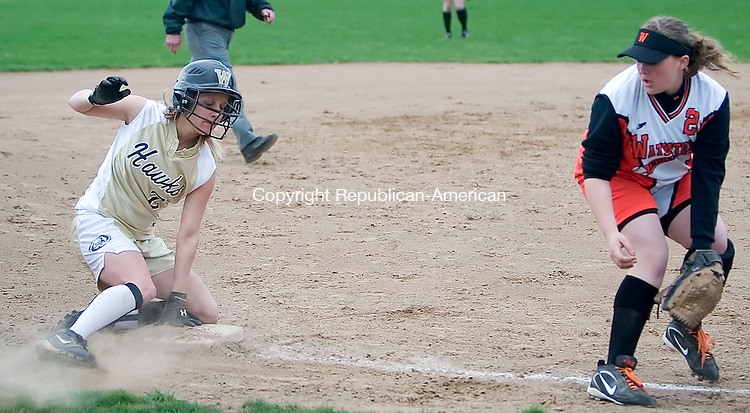 BEACON FALLS, CT -17 APRIL 2006 -040806JT04--<br /> Woodland's Alice Levinsky slides into third base just as Watertown's Amanda Coavette catches the ball from a throw at Monday's game at Woodland.<br /> Josalee Thrift Republican-American