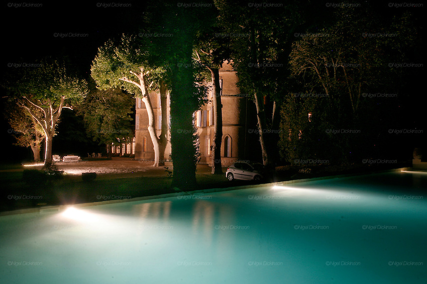 View of Chateau Robernier, from the swimming pool, on the eastside at night. The exterior is original and hasn't been touched by recent renovation works...Chateau Robernier located near Montfort, in the Var, closeby to Provence in southern France. The Chateau dates back to the 16th century with parts added in the 18th and 19th centuries. There is a vineyard attached with 80 hectares of land producing 200,000 bottles of wine per annum. The Chateau, bought in 2007, has been recently renovated by the new owners Mr Rune Andersen, aged 35, owner of several investment companies, including Scan-Tec, and his fiancée Miss Cecile Ruppmann who is Swiss German, aged 29. They both are resident in Monaco.
