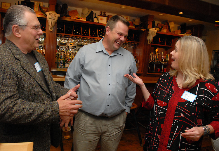 Senate candidate Jon Tester (D) talks with Ron and Elinore Pulcini at a fundraiser at the Mint Bar and Cafe in Belgrade, Montana.