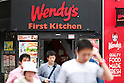 Pedestrians walk past a combined Wendy's and First-Kitchen joint fast food restaurant in Ueno on May 24, 2016, Tokyo, Japan. Japanese beverage manufacturer Suntory Holdings Ltd. announced on Monday that it will sell its shares in the First-Kitchen Ltd. hamburger chain to Wendy's Japan LLC. The First-Kitchen chain, which was launched in 1977, operates some 135 outlets in the Tokyo metropolitan area and western Japan and had sales of ¥8.7 billion ($79 million) in 2015. Wendy's plans to keep the First-Kitchen brand after the acquisition and operate joint branded restaurants. (Photo by Rodrigo Reyes Marin/AFLO)