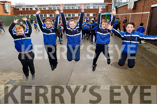 CBS NS students, Dominic Siegel, Olaf Krajnik, Maya Kwiatkowska,Thomas O'Mahoney and Britney Coffey leap for joy at the school on Monday at the Encouraging Fundamental Movement Skills and Physical Activities Initiative inside and outside of school.