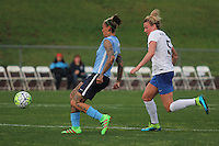 Piscataway, NJ, May 13, 2016. Sky Blue forward Tasha Kai passes away from Kassie Kallman (5) of the Boston Breakers.   Sky Blue FC defeated the Boston Breakers, 1-0, in a National Women's Soccer League (NWSL) match at Yurcak Field.