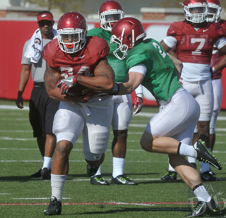 NWA Democrat-Gazette/MICHAEL WOODS &bull; @NWAMICHAELW<br /> Arkansas running back Kody Walker (24) runs drills during practice Thursday April 7, 2016, in Fayetteville.