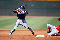 Cleveland Indians minor league shortstop Dorssys Paulino #13 attempts to turn a double play as Avain Rachal #78 slides in during an instructional league game against the Cincinnati Reds at the Goodyear Training Complex on October 8, 2012 in Goodyear, Arizona.  (Mike Janes/Four Seam Images)