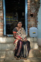 Rani barukaum, the SHG group leader poses for a portrait in the courtyard of her house in Ambedkar Nagar in Medak, Telangana, India.