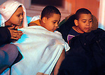 (Boston Ma., 01/02/15) Several children bundle up after being forced from their burning apartment house,  during a 2nd alarm fire on Bellevue that forced the displacement of 25 residents radio reports indicated, Friday, January 2, 2015, in Boston. Herald Photo by Jim Michaud