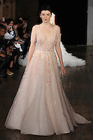 """Model walks runway in a """"Kiss"""" bridal gown from the Rivini by Rita Vinieris Fall 2017 collection on October 7th, 2016 during New York Bridal Fashion Week."""