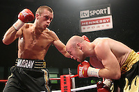 John Murray defeats Jon Thaxton  in a Lightweight Boxing contest for the British Title at Altrincham Leisure Centre, promoted by Hennessy Sports - 03/10/09 - MANDATORY CREDIT: Chris Royle/