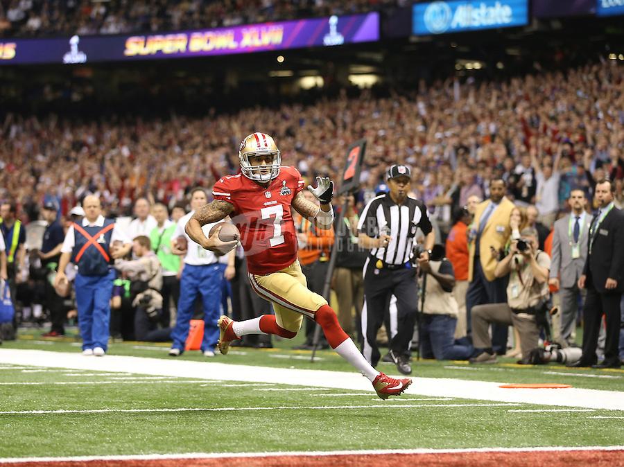 Feb 3, 2013; New Orleans, LA, USA; San Francisco 49ers quarterback Colin Kaepernick (7) scores a touchdown against the Baltimore Ravens in the fourth quarter in Super Bowl XLVII at the Mercedes-Benz Superdome. Mandatory Credit: Mark J. Rebilas-