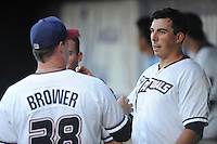 NWA Democrat-Gazette/ANDY SHUPE<br /> Northwest Arkansas Naturals starter Kyle Zimmer (right) speaks with pitching coach Jim Brower Wednesday, Aug. 12, 2015, against San Antonio at Arvest Ballpark in Springdale.