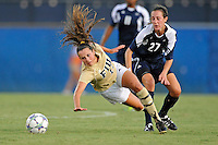 27 August 2011:  FIU's Marie Egan (13) is pushed by Akron's Maggie Rusnak (27) in the first half as the FIU Golden Panthers defeated the University of Arkon Zips, 1-0, at University Park Stadium in Miami, Florida.