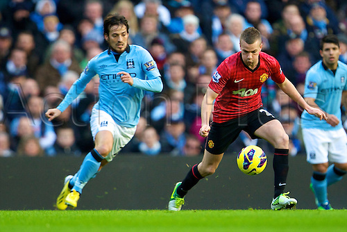 09.12.2012 Manchester, England. Manchester United's English midfielder Tom Cleverley and Manchester City's Spanish midfielder David Silva in action during the Premier League game between Manchester City and Manchester United from the Etihad Stadium. Manchester United scored a late winner to take the game 2-3.