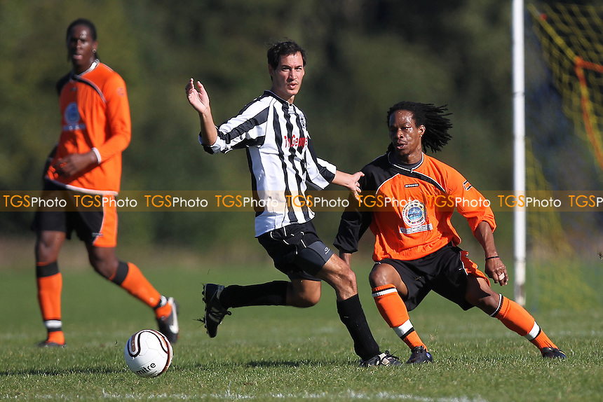 St Lucia United (orange/black) vs Millwall Albion - East London Sunday League Football at South Marsh, Hackney Marshes, London - 14/10/12 - MANDATORY CREDIT: Gavin Ellis/TGSPHOTO - Self billing applies where appropriate - 0845 094 6026 - contact@tgsphoto.co.uk - NO UNPAID USE.