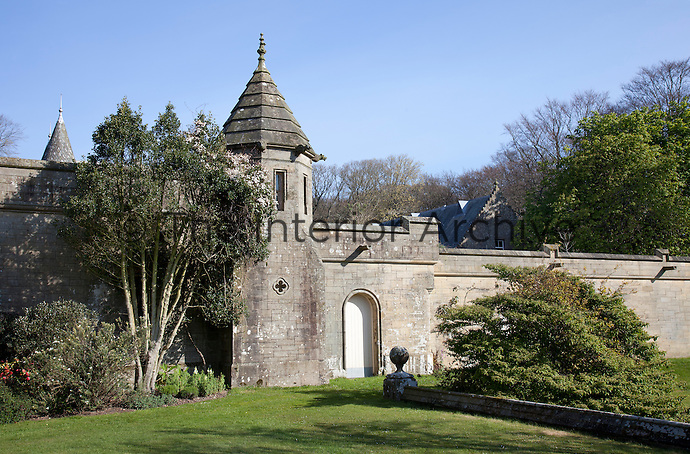 A Victorian tower built into the castellated wall of the garden