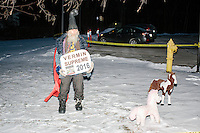 Satirical presidential candidate Vermin Supreme protests his exclusion from the Lesser-Known Candidates Debate outside Saint Anselm College's New Hampshire Institute of Politics in Goffstown, New Hampshire. Supreme participated in previous debates, but was told he would be not allowed back this year because of an incident during the 2011 debate in which Supreme threw glitter on candidate Randall Terry. The college put up police tape behind which the candidate was told to stand without risking arrest. Supreme's platform advocates a pony-based economy, using zombies to solve the energy crisis, and other outlandish ideas. Supreme has been on the New Hampshire primary ballot in 2008 and 2012, though he has began running for president in 1992.