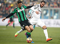Calcio, Serie A: Sassuolo vs Juventus. Reggio Emilia, Mapei Stadium, 29 gennaio 2017. <br /> Sassuolo's Federico Peluso, left, is challenged by Juventus' Gonzalo Higuain during the Italian Serie A football match between Sassuolo and Juventus at Reggio Emilia's Mapei stadium, 29 January 2017.<br /> UPDATE IMAGES PRESS/Isabella Bonotto