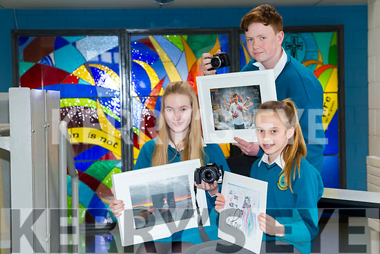 Three Mercy Mounthawk students have won awards for their photographs and Artwork  in the Mental Health Ireland photography competition l-r 5th year Aoife King with her picture 'Let your true colours shrine', 4th year Adam Butler, 1st year Alison Lane with her artwork 'All we need is colour'
