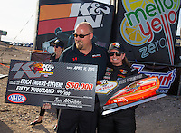 Apr 11, 2015; Las Vegas, NV, USA; NHRA pro stock driver Erica Enders-Stevens (right) celebrates with team owner Richard Freeman after winning the K&N Horsepower Challenge during the Summitracing.com Nationals at The Strip at Las Vegas Motor Speedway. Mandatory Credit: Mark J. Rebilas-