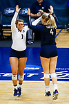 PENSACOLA, FL - DECEMBER 09: Tori Hanson (7) of and Shelby Seurer (4) of Concordia University, St. Paul high five during the Division II Women's Volleyball Championship held at UWF Field House on December 9, 2017 in Pensacola, Florida. (Photo by Timothy Nwachukwu/NCAA Photos via Getty Images)