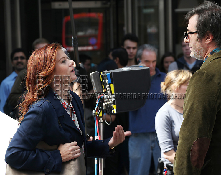 Debra Messing & Jon Robin Baitz filming a scene from the NBC TV Show 'Smash' in Times Square, New York City on September 12, 2012