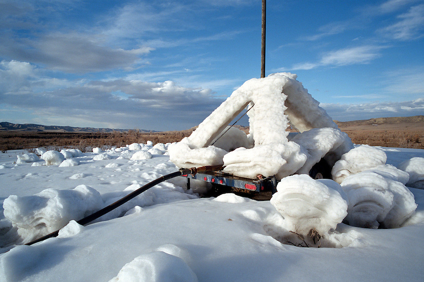White fields of ice build below a sprayer built to dispose of water from surrounding natural gas wells near Gillette, Wyo. A boom in coal bed methane extraction has raised controversy in property rights and environmental issues.