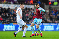 Swansea City's Mike van der Hoorn vies for possession with Burnley's Johann Gudmundsson<br /> <br /> Photographer Ashley Crowden/CameraSport<br /> <br /> The Premier League - Swansea City v Burnley - Saturday 10th February 2018 - Liberty Stadium - Swansea<br /> <br /> World Copyright &copy; 2018 CameraSport. All rights reserved. 43 Linden Ave. Countesthorpe. Leicester. England. LE8 5PG - Tel: +44 (0) 116 277 4147 - admin@camerasport.com - www.camerasport.com