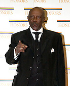 "Louis Gossett, Jr. arrives at the Harry S. Truman Building (Department of State) in Washington, D.C. on December 4, 2004 for a dinner hosted by United States Secretary of State Colin Powell.  At the dinner six performing arts legends will receive the Kennedy Center Honors of 2004.  This is the 27th year that the honors have been bestowed on ""extraordinary individuals whose unique and abundant artistry has contributed significantly to the cultural life of our nation and the world"" said John F. Kennedy Center for the Performing Arts Chairman Stephen A. Schwarzman.  The award recipients are: actor, director, producer, and writer Warren Beatty; husband-and-wife actors, writers and producers Ossie Davis and Ruby Dee; singer and composer Elton John; soprano Joan Sutherland; and composer and conductor John Williams.<br /> Credit: Ron Sachs / CNP"