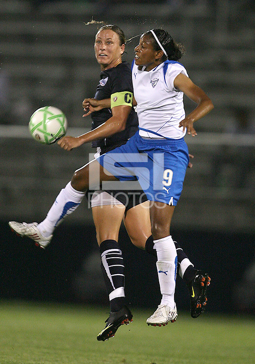 Abby Wambach #20 of the Washington Freedom and Candace Chapman #9 of the Boston Breakers clash during a WPS match at Maryland Soccerplex on July 29, in Boyds, Maryland. Freedom won 1-0.