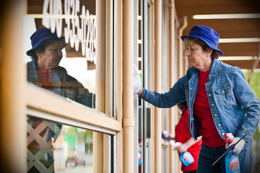 Dinah Thoreson, VP, relationship manager for KeyBank, washes the windows of storefronts in White Center while volunteering during KeyBank's 20th annual Neighbors Make the Difference Day on Tuesday, May 25, 2010. The event involved helping beautify the White Center business district. For years, the bank has provided volunteer help from local branches in Seattle-King County area - and across the country- and this year turned loose some 8,000 volunteers to improve their communities. (Photo by Dan DeLong/Red Box Pictures).