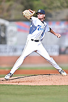 Asheville Tourists starting pitcher Sam Howard (32) delivers a pitch during game one of a double header against the Hickory Crawdads on April 21, 2015 in Asheville, North Carolina. The Crawdads defeated the Tourists 10-1. (Tony Farlow/Four Seam Images)