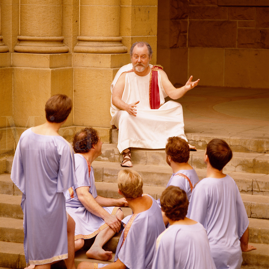 Philosopher teaching students on ancient steps.