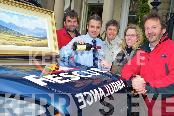 Sean Tracey, Finbarr Kennelly, Grace Foley and Ciara Irwin Foley, Killarney Rotary Club, with John O'Sullivan, Kerry Mountain Rescue Team, one of the beneficiaries of the Rotary Clubs Wine and Art night, which was launched in The Malton Hotel on Wednesday.