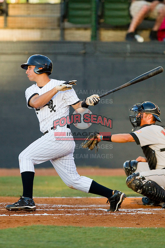 Rangel Ravelo #25 of the Bristol White Sox follows through on his swing against the Greeneville Astros at Boyce Cox Field July 1, 2010, in Bristol, Tennessee.  Photo by Brian Westerholt / Four Seam Images