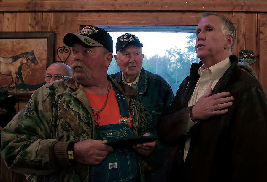 MOCKSVILLE, NC - NOVEMBER 2:  North Carolina Republican U.S. Senate candidate Thom Tillis, right, recites the Pledge of Allegiance next to Eddie Frank, front left, and Eddie Frank's father Harold Frank, center, during Tillis' campaign stop at Miller's Restaurant in Mocksville, NC, on Sunday, November 2, 2014.  (Photo by Ted Richardson/For The Washington Post)