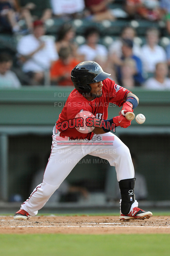 Second baseman Wendell Rijo (11) of the Greenville Drive bats in a game against the Asheville Tourists on Tuesday, July 1, 2014, at Fluor Field at the West End in Greenville, South Carolina. Rijo is the No. 18 prospect of the Boston Red Sox, according to Baseball America. Asheville won, 5-2. (Tom Priddy/Four Seam Images)