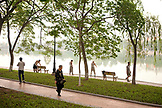 VIETNAM, Hanoi, people stretch, exercise and practice Tai Chi early in the morning, Hoan Kiem Lake and Pagota